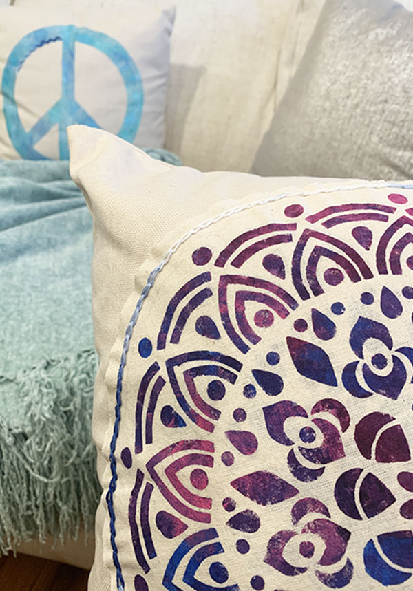 close up of decorative medallion pillow showing detail