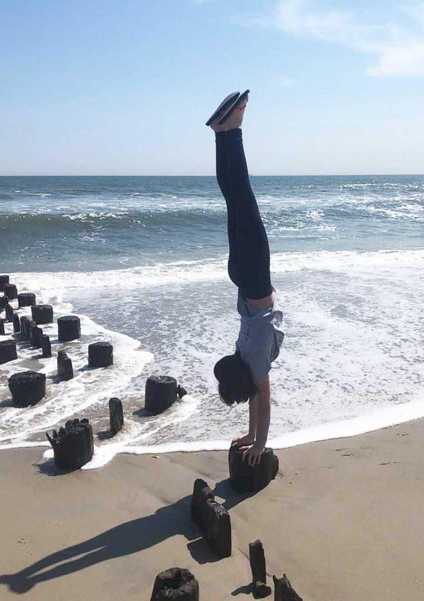 Alex doing a handstand on beach