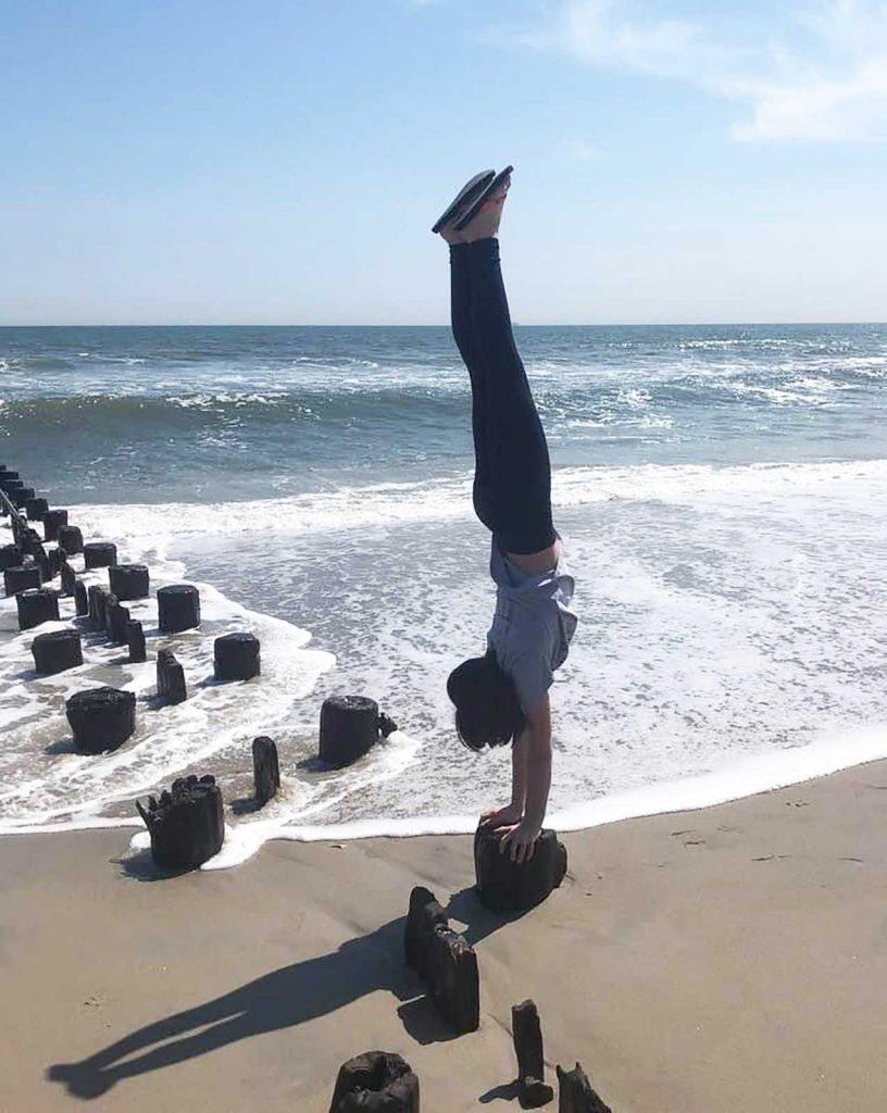 Alex doing a handstand on the beach