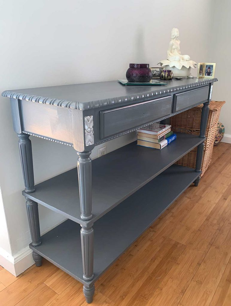 painted grey console table with silver leaf accents
