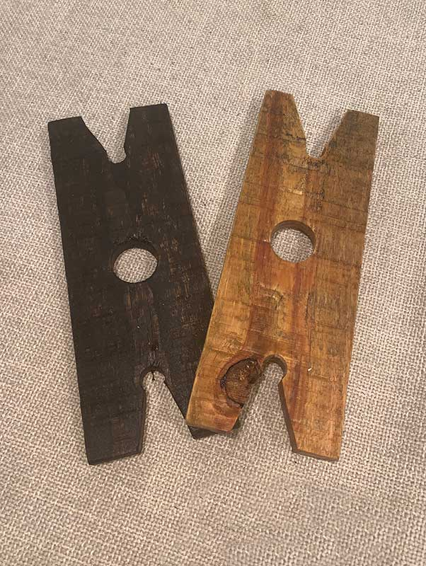Wood Pallet wine holders in two finishes. One in dark grey, one in natural wood grain.
