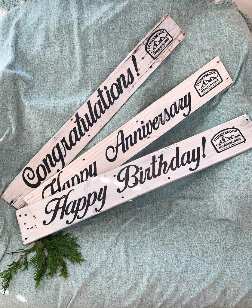 white wood pallet signs that say in grey handpainted letters Congratulations, happy birthday ad happy anniversary