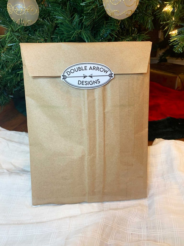 double arrow designs shipping envelope under the christmas tree