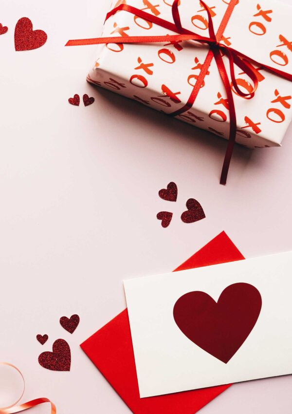 Valentines day gift with card and red hearts