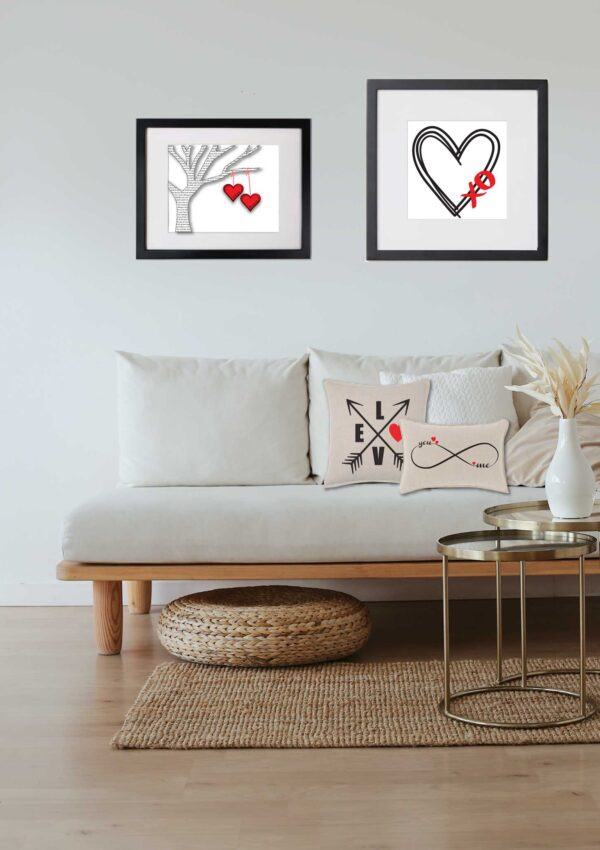 Valentines day art in livingroom. two in black frames on walls . two on pillows on couch