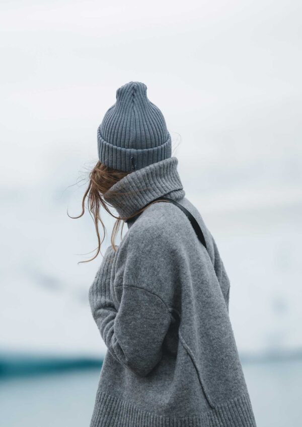 woman in grey hat and grey turtleneck sweater