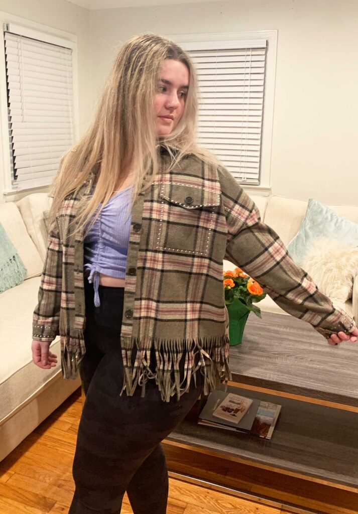 girl in plaid shacket with fringe