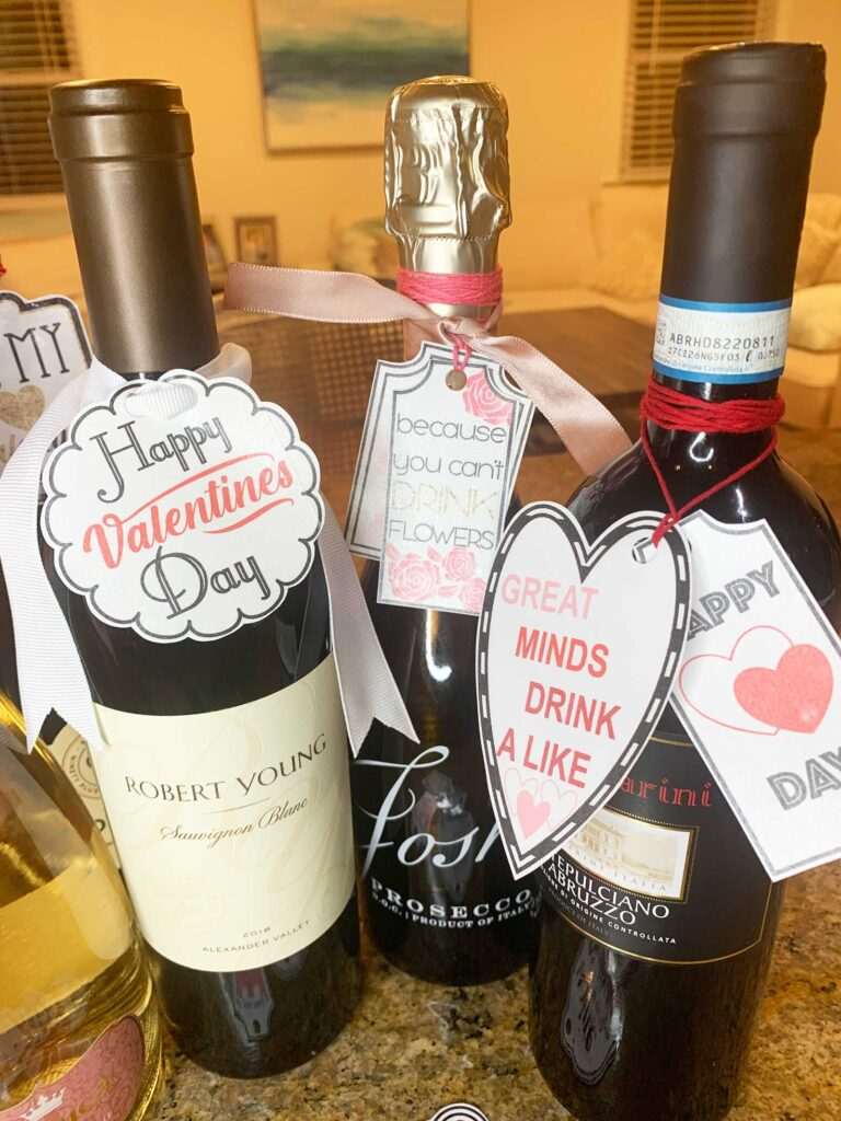 Valentines day wine tags on three bottles