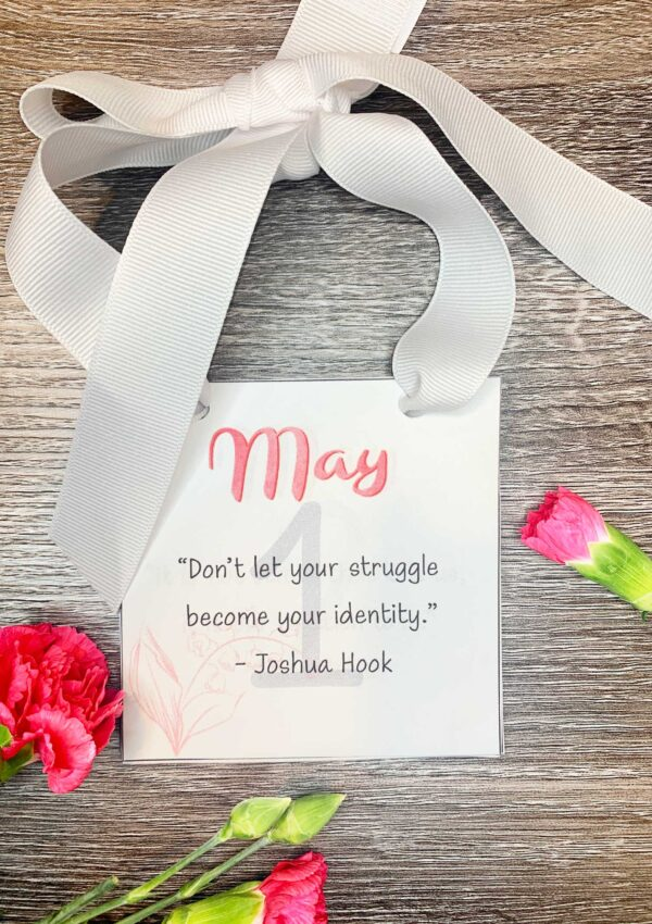 may 2021 calendar pages with inspirational quotes tied with white ribbon