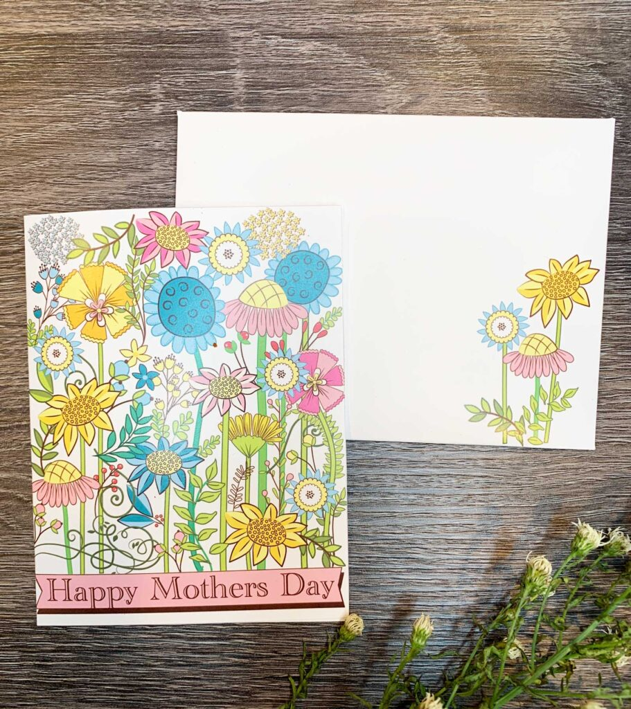 mother's day card printed with retro flowers with matching envelope on table