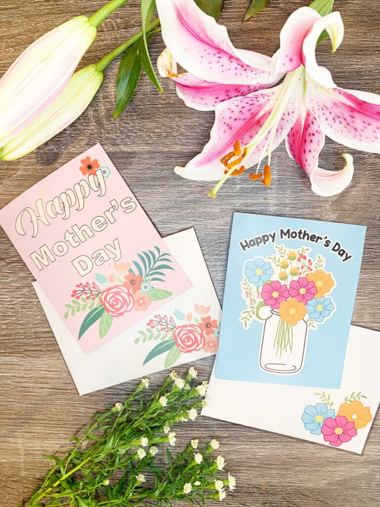 two mothers day cards on table with flowers one