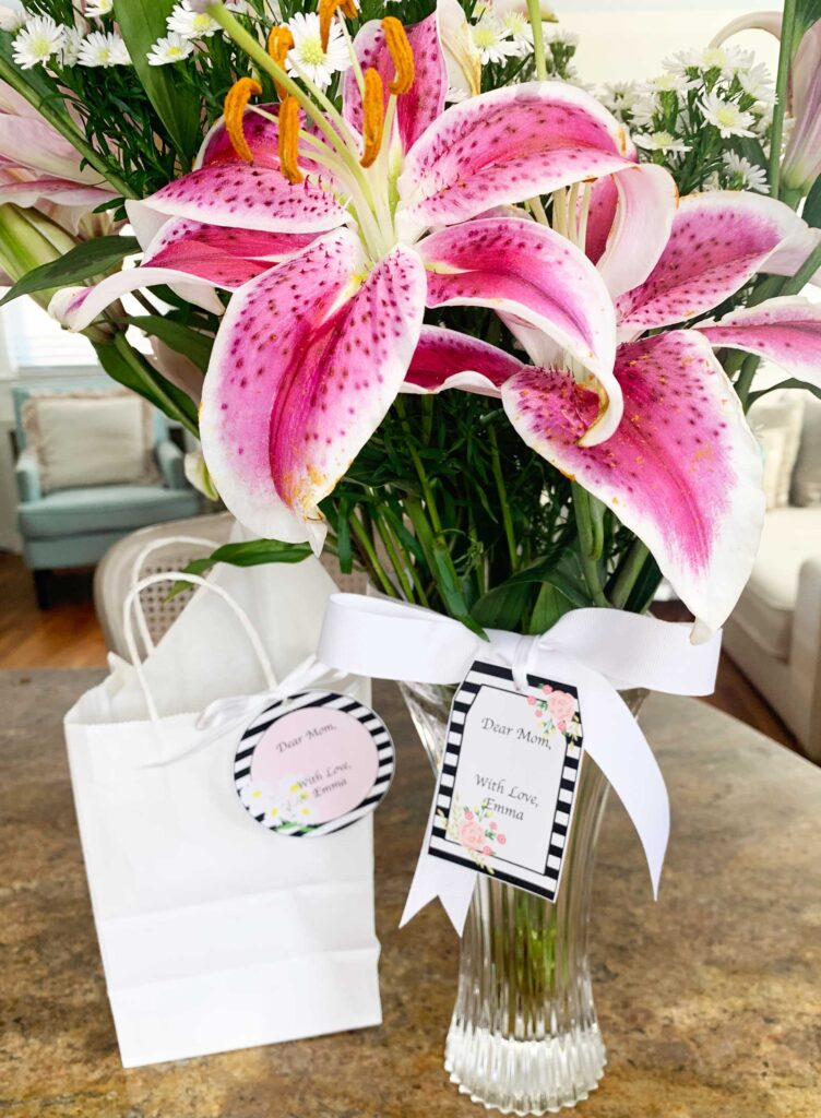 Bouquet of flowers and gift bag with mothers day gift tags attached