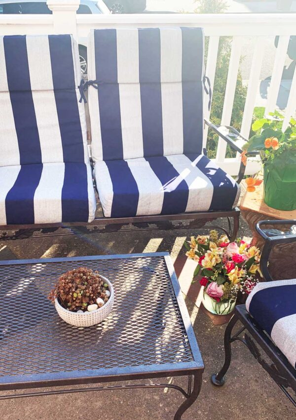 painted metal outdoor and navy striped cushions