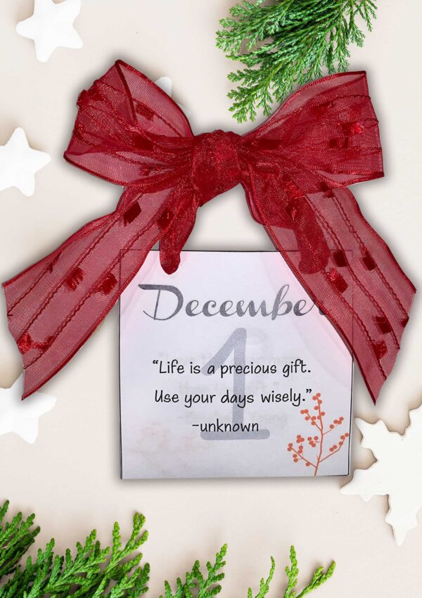december inspirational calendar with a red ribbon