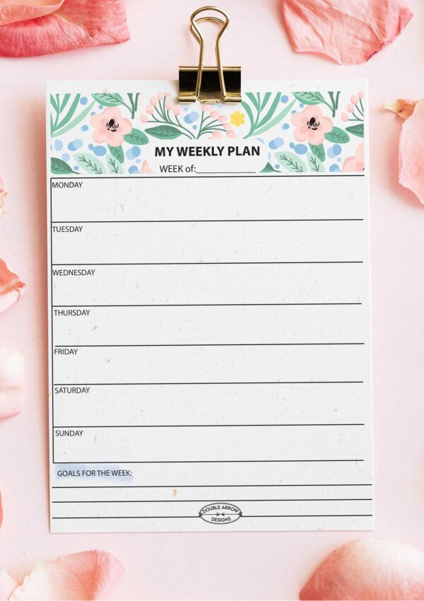 Floral weekly planner on a table w flower petals